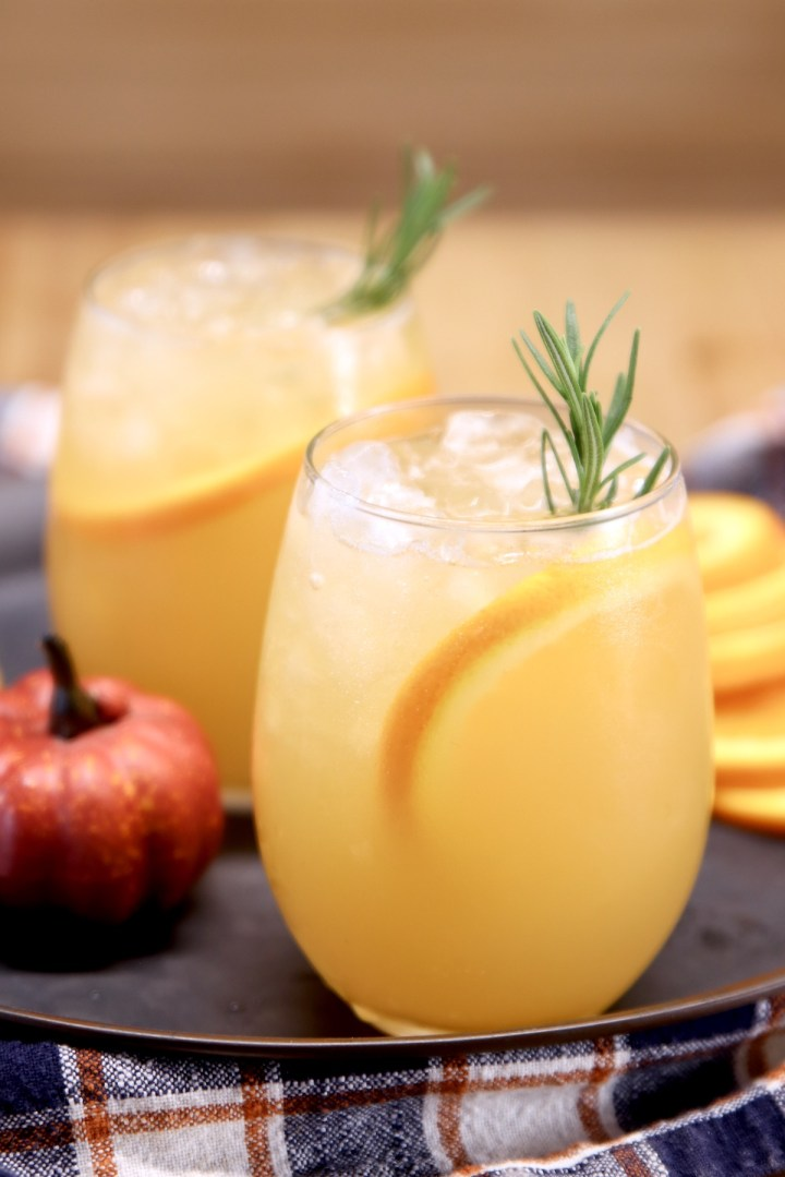 harvest punch cocktail in 2 stemless wine glasses