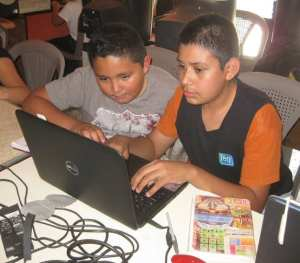 Students at our community center learning computer skills and doing homework