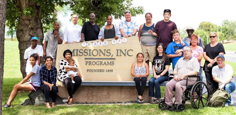 Residents by Missions Inc. sign