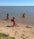Cottage kids at the beach in the water