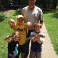 Cottage kids holding fish