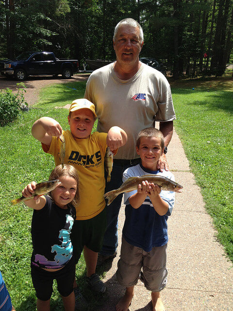 Nohl kids and Grandpa with fish
