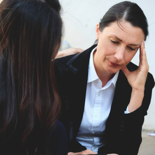 Woman at work with menopausal symptoms