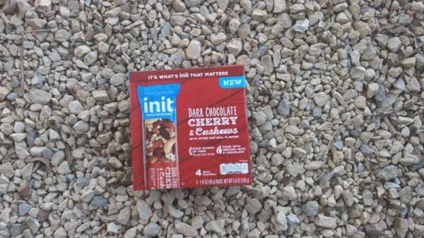 INIT bars laying in the gravel on an everyday adventure