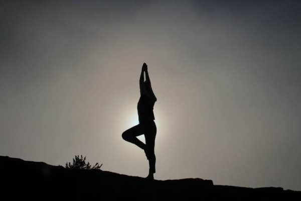 black and white yoga pose silhouette to boost your confidence