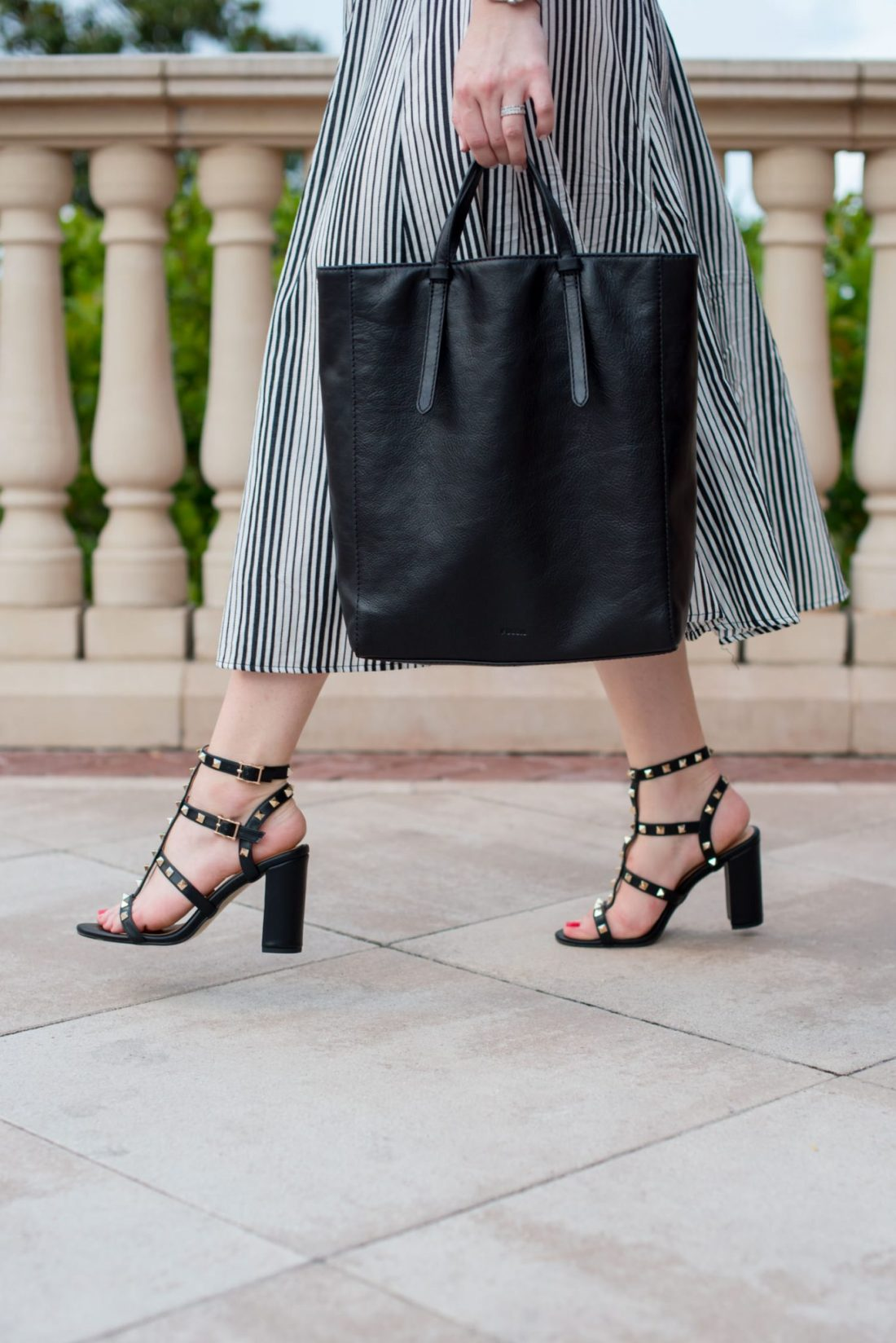 Cocktail Hour on the Coast + Affordable Valentino Rockstud DUPES // Miss Molly Moon    The Best Valentino Rockstud Dupes featured by top Atlanta fashion blogger, Miss Molly Moon: image of a woman wearing a striped maxi skirt, Old Navy Tee, Valentino rocketed dupes, FOSSIL convertible backpack