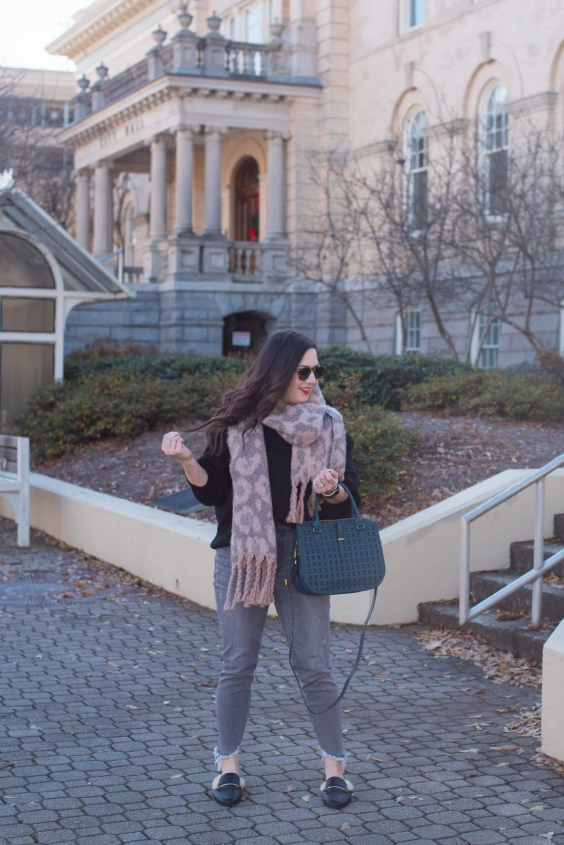 Cozy off the shoulder sweater styled by top US fashion blogger, Miss Molly Moon: image of a woman wearing an H&M off the shoulder sweater, Target blanket scarf, Express high waisted ankle denim leggings, Fossil bag and Target faux leather fur mules