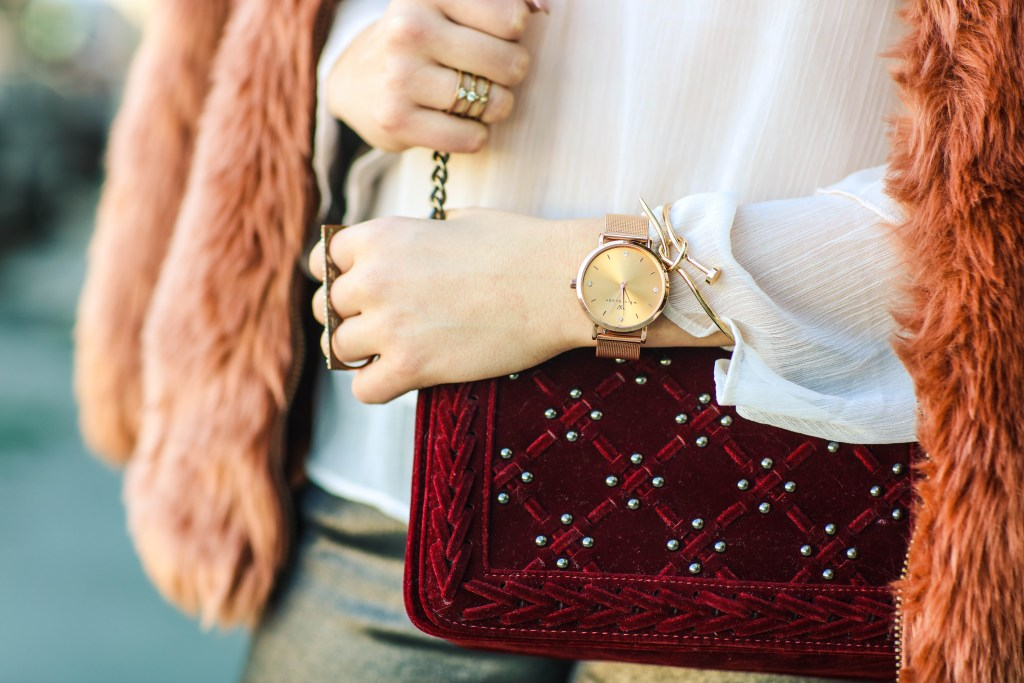 rose gold watch with velvet purse