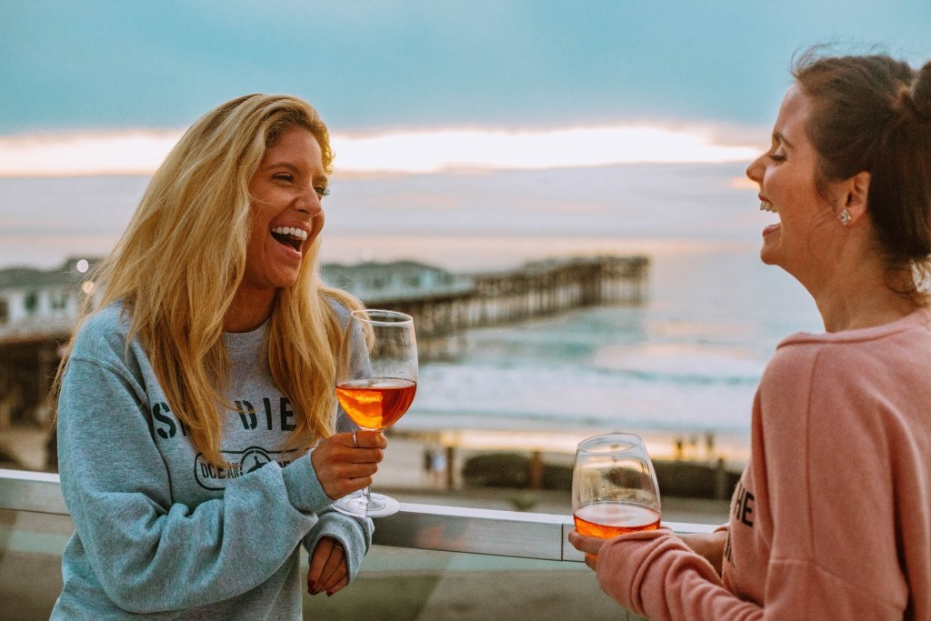 Girls drinking rose near the beach in San Diego, CA
