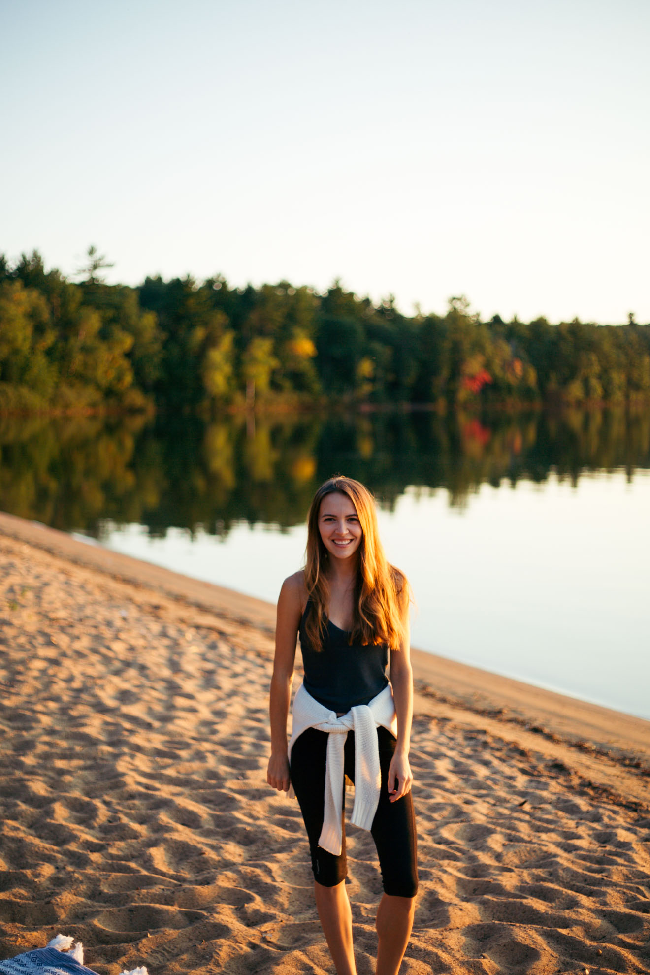 girl standing on beach in wisconsin