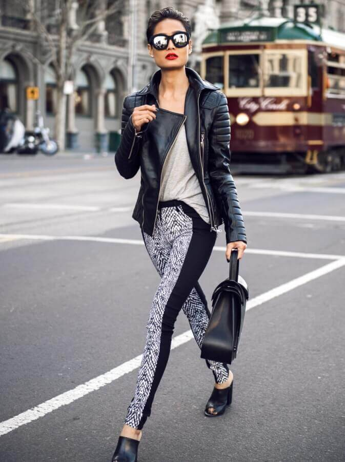 4. graphic print leggings with biker jacket and tee - 7 Chic Outfit Ideas: What to Wear with Leggings
