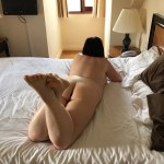 naked woman on hotel bed oblivious to world around her