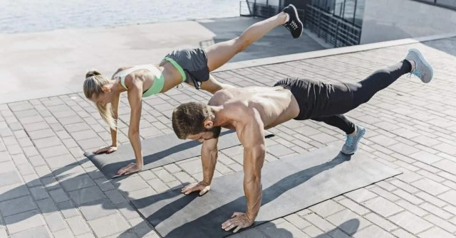Health and fitness tips- man and woman doing pushups lifting one leg.