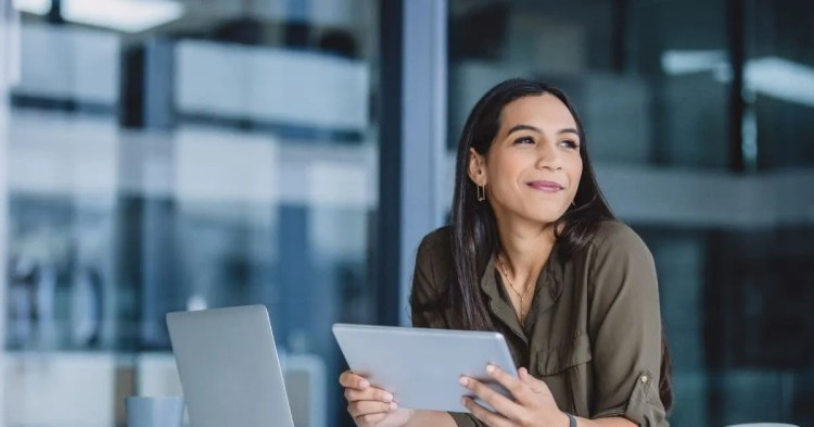 How to be successful in life- smiling woman at work on computer