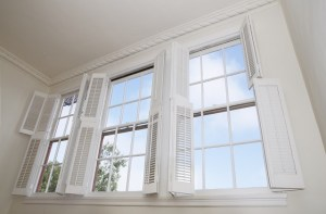 High windows in a home showcasing the need for a professional window cleaning service