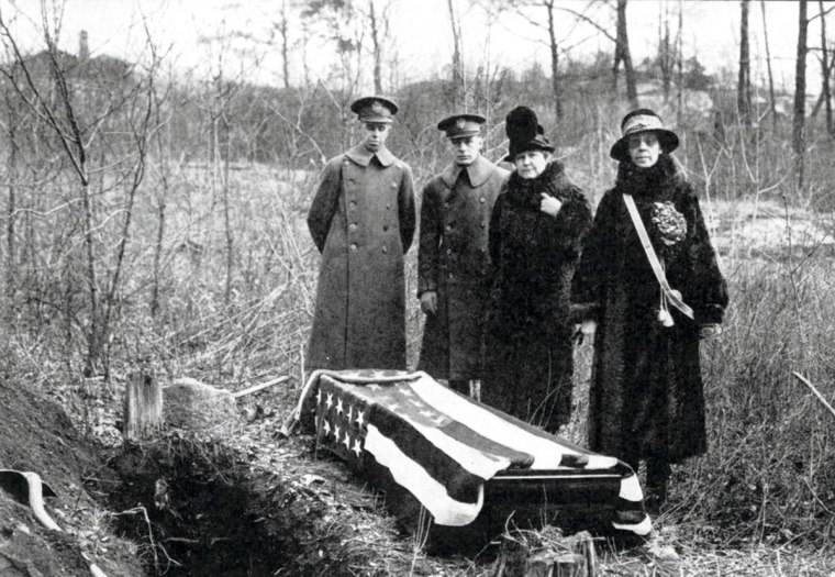 This 1926 photo provided by the Daughters of the American Revolution (DAR) shows a casket that was exhumed by the DAR on the estate of banker J.P. Morgan in Highland Falls, N.Y., with two women who were DAR researchers, right, and two Army officers to serve as pall bearers. The casket, which was reburied at the U.S. Military Academy in West Point, was thought to contain the remains of Revolutionary War hero Margaret