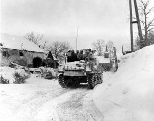 Members of Company I, 3d Battalion, 16th Infantry Regiment, 1st Division, U.S. First Army, ride on a tank, during their advance on the town of Schopen, Belgium. January 21, 1945 (Photo: U.S. Army, Sergeant Bill Augustine)
