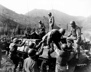 Medical corpsmen of the 1st Battalion Aid Station, 31st Infantry Regiment, 7th U.S. Infantry Division, assist in helping wounded infantrymen of Companies D and L, 31st Regiment, following the fight for Hill 598. 14 October 1952. Kumhwa, Korea. (Photo: U.S. Army)