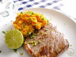 sweet potato with lime and beef steak on a plate for lunch
