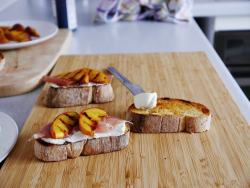 3 bruschette breads over a wooden board with cream cheese