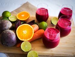 power breakfast smoothie in 4 glasses and fresh fruits on a wooden board