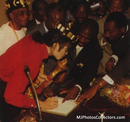 """Michael with the elders signing his official Title: """"King Sani"""""""