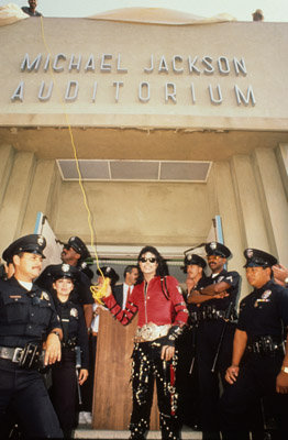 Michael Unveils his name on the Auditorium during the dedication