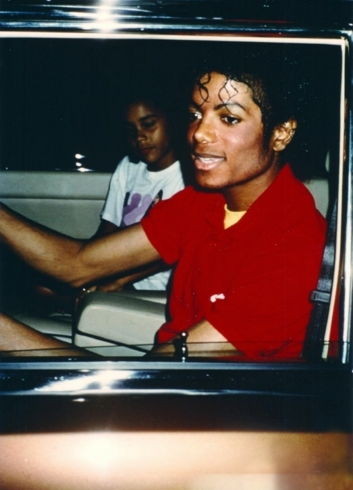 Michael driving with his niece.