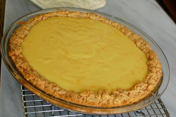If you're dreaming of white sand beaches and palm trees, this recipe for easy beach pie is just what you need. Its unique crust, made with saltine crackers, adds the perfect salty accent to the sweet and tangy filling. | mjbakesalot.com
