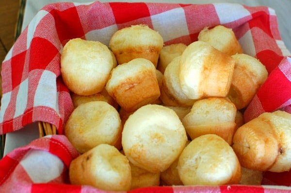 Serve blender Brazilian cheese puffs (aka Pao de Queijo) in the morning with strong coffee or later in the day with cocktails. The recipe is super simple to make so you won't mind when your family and guests beg you to make them often. | mjbakesalot.com