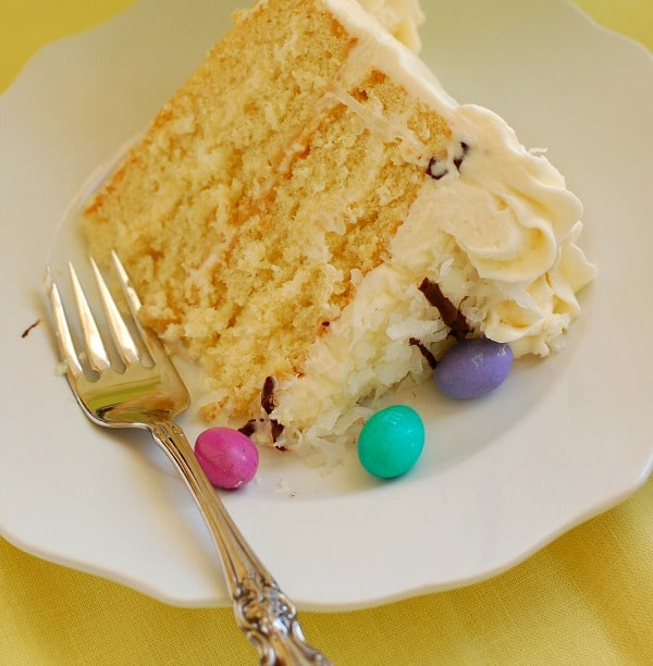 This easy recipe for Sensational Coconut Layer Cake with Coconut Cream Cheese Frosting has golden layers of moist butter cake alternating with everyone's favorite frosting. Make it for Easter, for spring, for a birthday, for your book club!   mjbakesalot.com