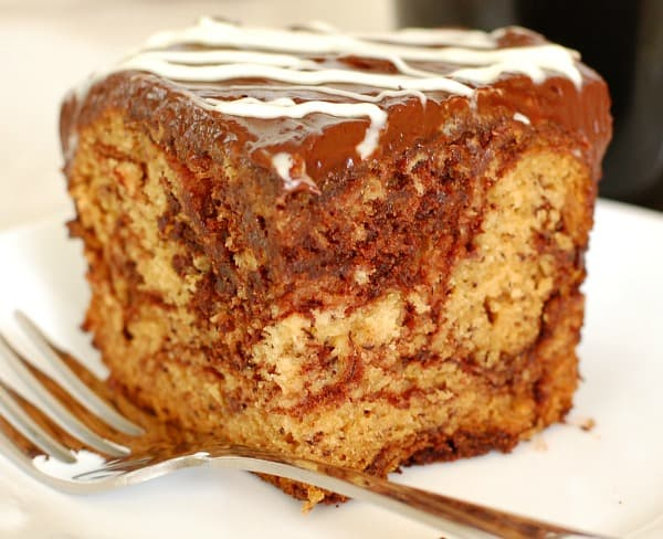 Try moist and luscious chocolate swirl banana cake with silky ganache frosting; it's an easy recipe and perfect for a potluck. | mjbakesalot.com