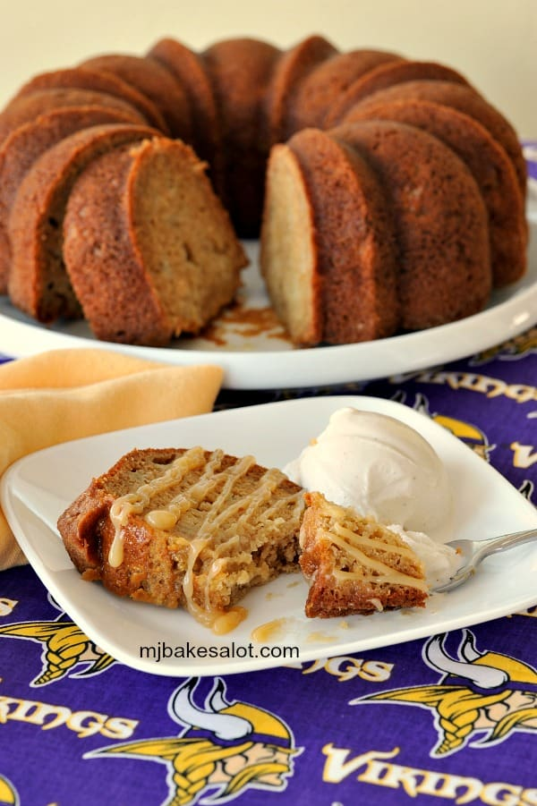 Honey apple Bundt cake drizzled with apple caramel sauce is accompanied by a scoop of vanilla bean ice cream. | mjbakesalot.com