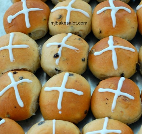 Hot cross buns are baked and decorated and ready to be enjoyed. | mjbakesalot.com