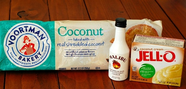 Piña colada pie starts with a crust made from coconut cookies, then dry instant pudding mix is added to the filling and coconut rum is used in both the filling and the topping.   mjbakesalot.com