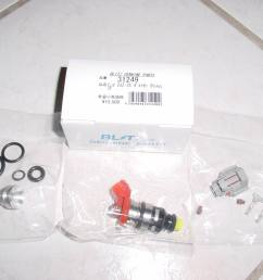 this what you get in the box 1 injector with 2 seals on it 4 seals in a bag and an aluminum adaptor that goes inside the stock rail harness kit  [ 1280 x 960 Pixel ]