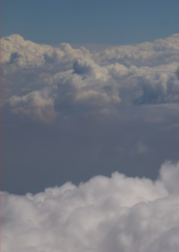Cumulus clouds and atmospheric boundary layer seen from Ryanair, cropped image