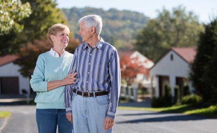retirement-community-couple-walking-exterior