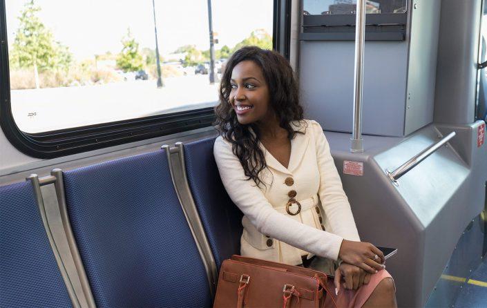 female-passenger-rider-smiling