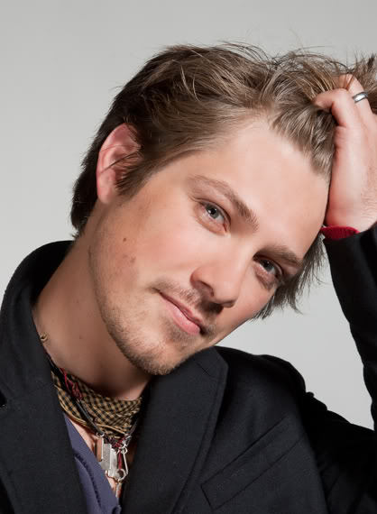"Interview: Taylor Hanson Talks ""MMMBop"" History, His No. 1 Tour Bus Necessity."