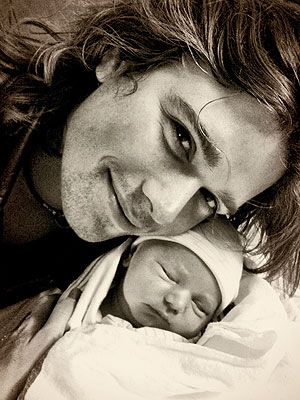 Zac Hanson with new son, George Abraham Walker