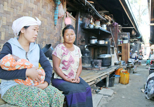 Kachin women displaced by recent clashes sit in an IDP camp.(Carole Oudot/The Myanmar Times)