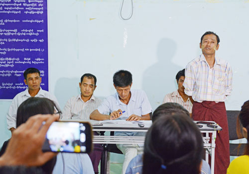 Seafood industry migrant workers hold a press event yesterday. Photo: Zaw Zaw Htwe / The Myanmar Times