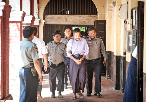 Kyi Lin, the alleged gunman, being brought to the Yangon Northern District Court for registration last Friday. Aung Khant / The Myanmar Times