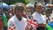 Children waving British Flag [Photo - Solomon Focus]