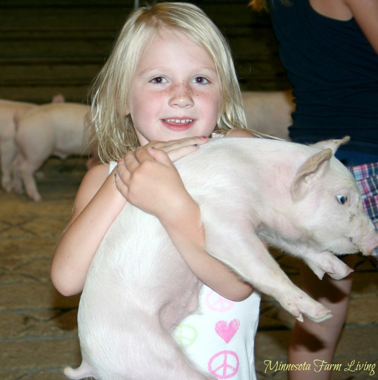 Miss J. with a pig