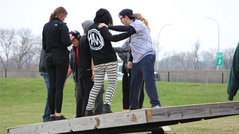 Base camp students balancing