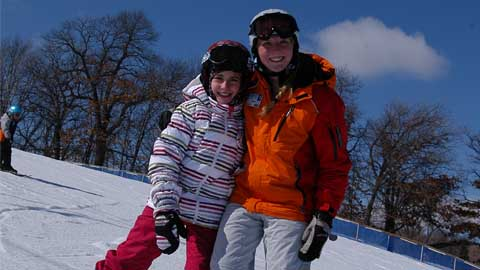 two kids snowboarding