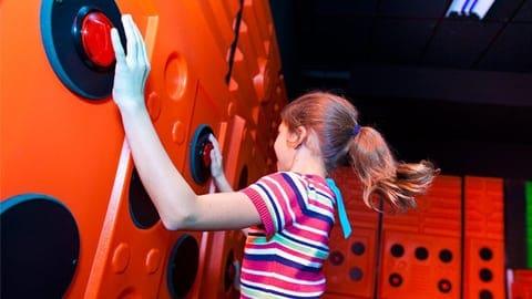 girl climbing wall