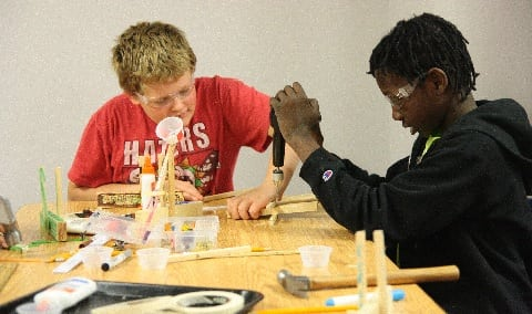 Kids building catapults